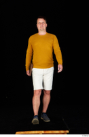 Paul Mc Caul blue shoes casual dressed standing white shorts whole body yellow sweatshirt 0033.jpg