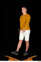 Paul Mc Caul blue shoes casual dressed standing white shorts whole body yellow sweatshirt 0034.jpg
