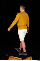 Paul Mc Caul blue shoes casual dressed standing white shorts whole body yellow sweatshirt 0036.jpg