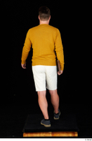 Paul Mc Caul blue shoes casual dressed standing white shorts whole body yellow sweatshirt 0037.jpg