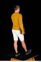 Paul Mc Caul blue shoes casual dressed standing white shorts whole body yellow sweatshirt 0038.jpg