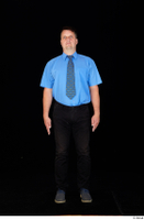 Paul Mc Caul black belt black trousers blue shirt blue shoes business dressed standing tie whole body 0001.jpg