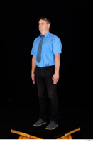 Paul Mc Caul black belt black trousers blue shirt blue shoes business dressed standing tie whole body 0002.jpg
