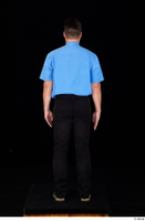 Paul Mc Caul black belt black trousers blue shirt blue shoes business dressed standing tie whole body 0005.jpg