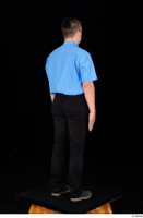 Paul Mc Caul black belt black trousers blue shirt blue shoes business dressed standing tie whole body 0006.jpg