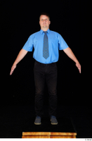 Paul Mc Caul black belt black trousers blue shirt blue shoes business dressed standing tie whole body 0009.jpg