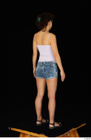 Shrima black sandals dressed jeans shorts pink top standing whole body 0007.jpg