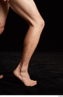 Gruffydd  1 calf flexing nude side view 0006.jpg
