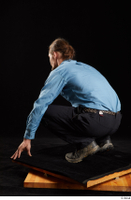 Gruffydd  1 black shoes black trousers blue shirt dressed kneeling whole body 0004.jpg