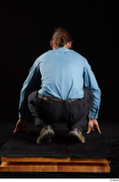 Gruffydd  1 black shoes black trousers blue shirt dressed kneeling whole body 0005.jpg