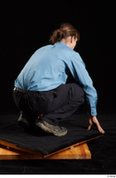 Gruffydd  1 black shoes black trousers blue shirt dressed kneeling whole body 0006.jpg