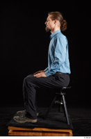 Gruffydd  1 black shoes black trousers blue shirt dressed sitting whole body 0001.jpg