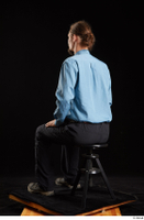 Gruffydd  1 black shoes black trousers blue shirt dressed sitting whole body 0002.jpg