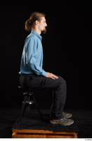 Gruffydd  1 black shoes black trousers blue shirt dressed sitting whole body 0005.jpg