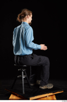 Gruffydd  1 black shoes black trousers blue shirt dressed sitting whole body 0012.jpg