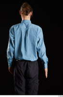 Gruffydd  1 arm back view black trousers blue shirt dressed flexing 0001.jpg