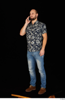 Orest blue jeans blue shirt brown shoes calling casual dressed standing whole body 0002.jpg