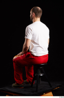 Orest  1 dressed grey shoes jogging suit red panties sitting white t shirt whole body 0002.jpg
