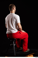 Orest  1 dressed grey shoes jogging suit red panties sitting white t shirt whole body 0004.jpg