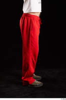 Orest  1 dressed flexing grey shoes jogging suit leg red panties side view 0001.jpg