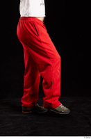Orest  1 dressed flexing grey shoes jogging suit leg red panties side view 0003.jpg