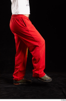 Orest  1 dressed flexing grey shoes jogging suit leg red panties side view 0004.jpg