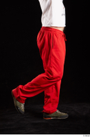Orest  1 calf dressed flexing grey shoes jogging suit red panties side view 0002.jpg