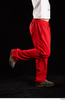 Orest  1 calf dressed flexing grey shoes jogging suit red panties side view 0003.jpg