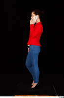 Rania black high heels blue jeans calling casual dressed phone pink top red jacket standing whole body 0003.jpg