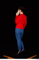 Rania black high heels blue jeans calling casual dressed phone pink top red jacket standing whole body 0004.jpg