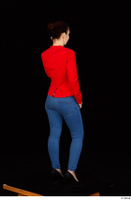 Rania black high heels blue jeans calling casual dressed phone pink top red jacket standing whole body 0006.jpg