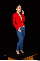 Rania black high heels blue jeans calling casual dressed phone pink top red jacket standing whole body 0008.jpg