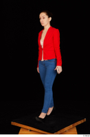Rania black high heels blue jeans casual dressed phone pink top red jacket walking whole body 0002.jpg