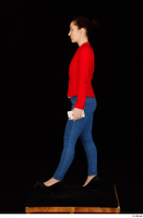 Rania black high heels blue jeans casual dressed phone pink top red jacket walking whole body 0003.jpg