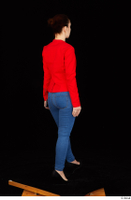 Rania black high heels blue jeans casual dressed phone pink top red jacket walking whole body 0006.jpg