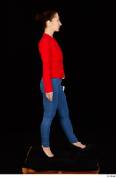 Rania black high heels blue jeans casual dressed phone pink top red jacket walking whole body 0007.jpg