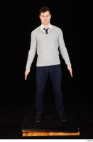 Tomas Salek black shoes blue trousers business clothing dressed grey sweater standing tie white t shirt whole body 0001.jpg