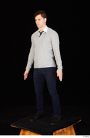 Tomas Salek black shoes blue trousers business clothing dressed grey sweater standing tie white t shirt whole body 0002.jpg