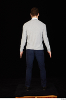Tomas Salek black shoes blue trousers business clothing dressed grey sweater standing tie white t shirt whole body 0005.jpg