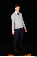 Tomas Salek black shoes blue trousers business clothing dressed grey sweater standing tie white t shirt whole body 0008.jpg