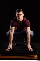 Tomas Salek  1 blue jeans dressed grey shoes kneeling red t shirt whole body 0001.jpg