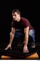 Tomas Salek  1 blue jeans dressed grey shoes kneeling red t shirt whole body 0002.jpg