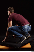 Tomas Salek  1 blue jeans dressed grey shoes kneeling red t shirt whole body 0004.jpg