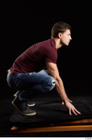 Tomas Salek  1 blue jeans dressed grey shoes kneeling red t shirt whole body 0007.jpg