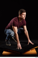 Tomas Salek  1 blue jeans dressed grey shoes kneeling red t shirt whole body 0008.jpg