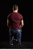 Tomas Salek  1 blue jeans dressed grey shoes red t shirt sitting whole body 0003.jpg