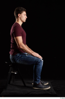 Tomas Salek  1 blue jeans dressed grey shoes red t shirt sitting whole body 0005.jpg