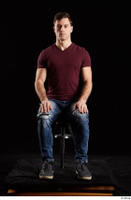 Tomas Salek  1 blue jeans dressed grey shoes red t shirt sitting whole body 0007.jpg