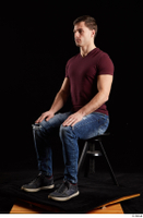 Tomas Salek  1 blue jeans dressed grey shoes red t shirt sitting whole body 0008.jpg
