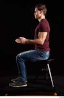 Tomas Salek  1 blue jeans dressed grey shoes red t shirt sitting whole body 0009.jpg